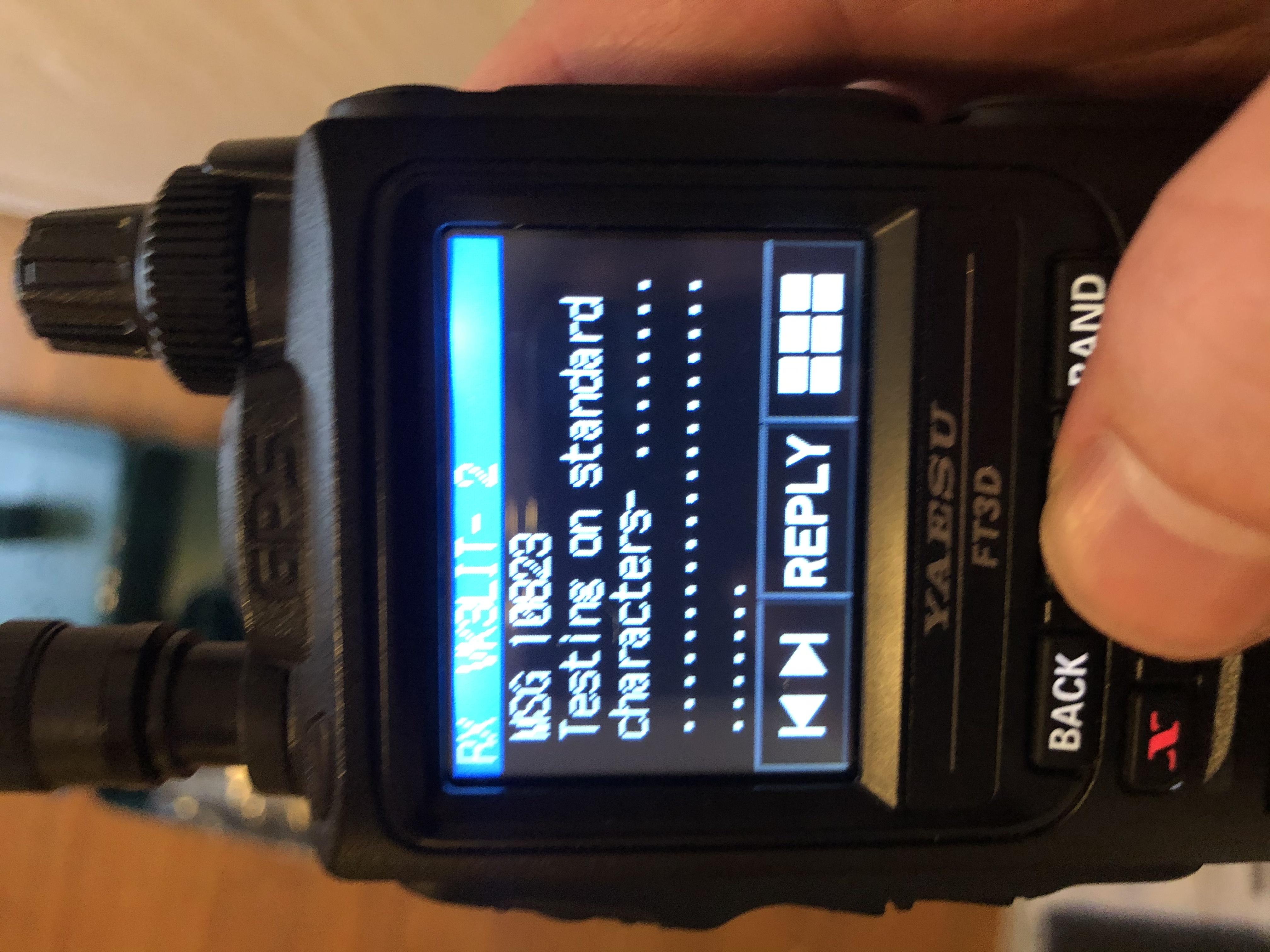 Close-up of Yaesu FT-3D receiving a message